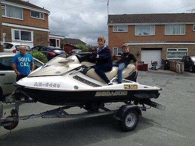 jetski GTX gold  with roller trailer