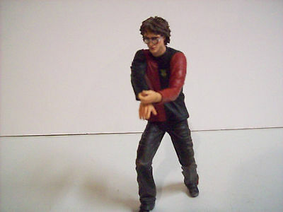 "Harry Potter 6"" figure in Quidditch jersey."