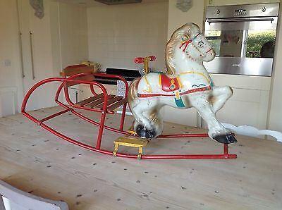 Vintage rocking horse,mobo tin toy horse.wooden seat.