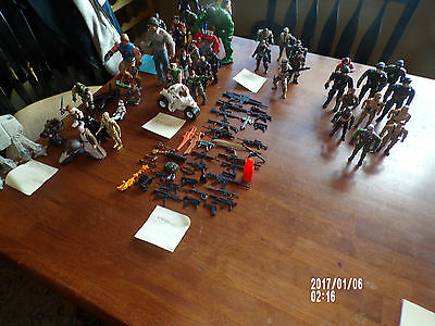 lot of 93 action figures and weapons