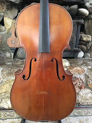 Old Cello Labeled For Repair