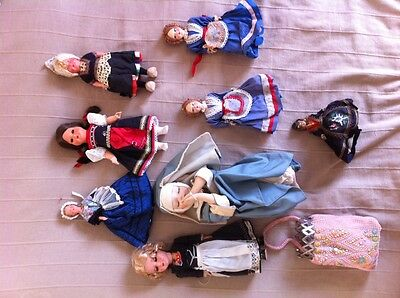 8 X antique dolls and pouch