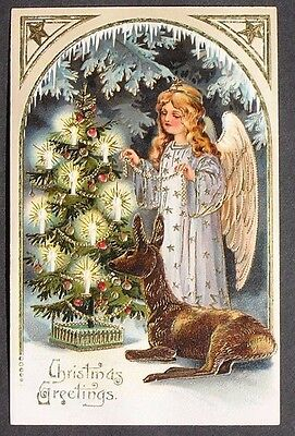 PFB Stunning Angel Puts Gold Bead Garland on Candle Lit Christmas Tree by Deer