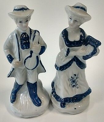 Pair of Porcelain White and Blue Painted Porcelain Figurines