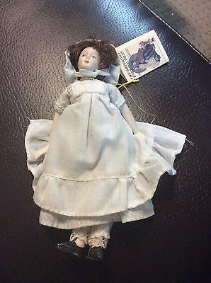 Norman Rockwell Saturday Evening Post Porcelain & Cloth Hanging Doll Ornament