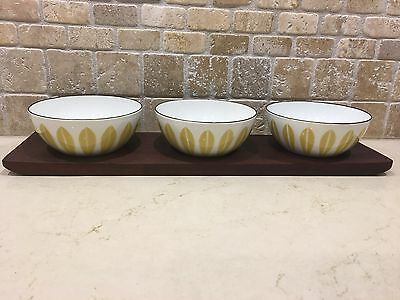 Catherineholm Gold and White Lotus enamelware bowl set on SIGNED Teak Tray