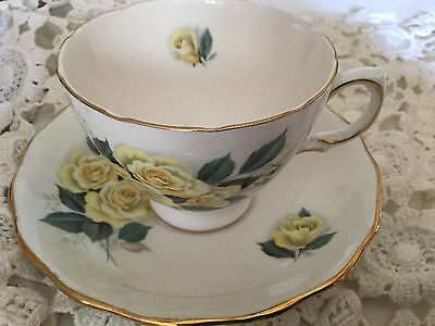 Royal Vale Bone China Cup And Saucer England    White/yellow Roses