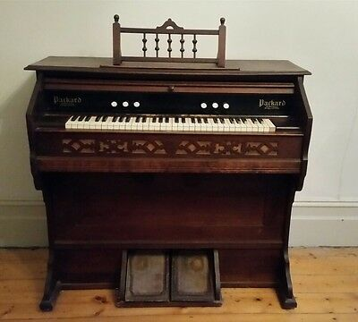 Antique pump organ by Packard USA