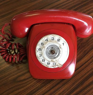 Retro vintage red rotary dial phone