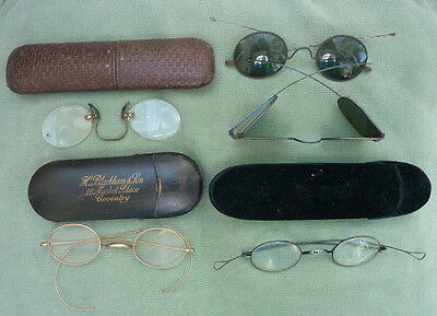 Vintage spectacles/glasses and their cases.