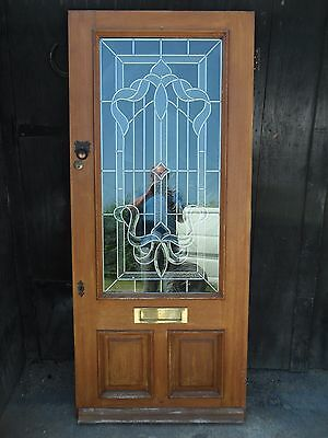 ** Solid Wood Front Door ** Looks Very Nice With Patterned / Leaded Glass **