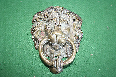 Vintage cast brass lion head door knocker with verdi gris.