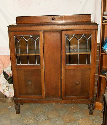 1920s oak glazed cabinet/bookcase