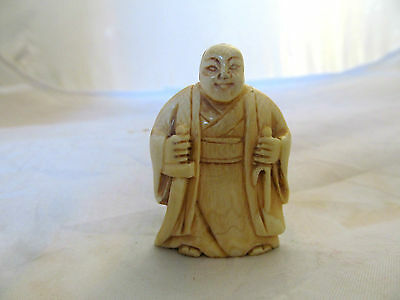 collectible old japanese carved netsuke, a man with a sword, unsigned .