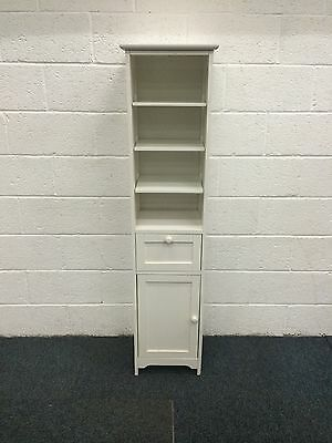 Tall Thin White Shelving Unit With Cupboard And Drawer