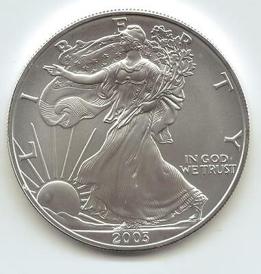 2003  Uncirculated American Silver Eagle  1-Troy oz. .999 Silver. Eagle is White