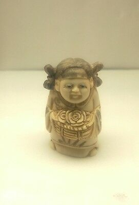 antique hand carved and signed chinese netsuke woman holding roses