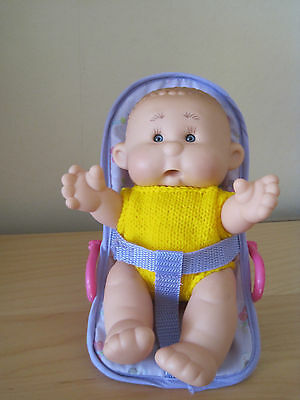 """Yogurtinis Charlie Coconut Scented Baby Doll 9"""" and Rocker"""