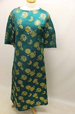 Green and gold oriental dress.