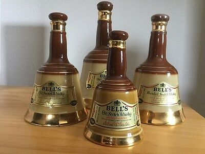 Set of four Bells Whisky Decanters ( no alcohol)