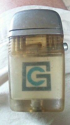 Scripto  Vu-Lighter Transparent band with the initials CG inside old - Used