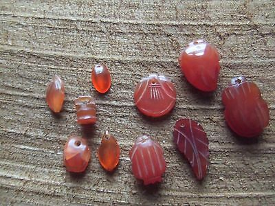 Chinese.   Cornelian.   10, Carved Pendant Drops.  Pierced.    Nice Condition.