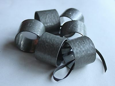 VINTAGE HAMMERED PEWTER NAPKIN RINGS 6 engraved with various numbers, ex Army?
