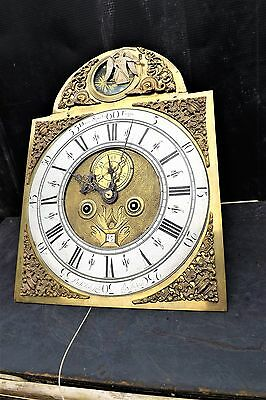 8 day brass dial with automaton movement.