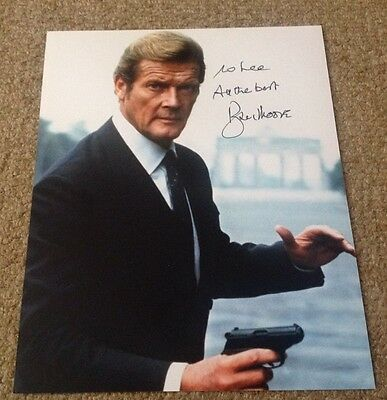 ROGER MOORE  -  007 JAMES BOND  -  SIGNED -  10x8  COL PHOTO -  INSC TO  LEE