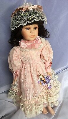 Collectible Porcelain Doll In Pink.