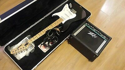 Peavey electric guitar, hard case and Peavey amp