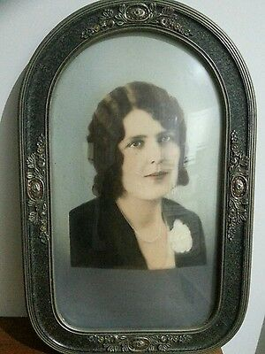 Antique picture frame with curved convex glass.