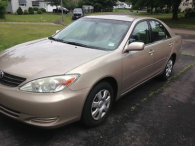 2003 Toyota Camry LE 2003 TOYOTA CAMRE LE 90,000 orig. miles One Family owned since new Salvage Title