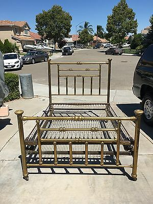 Vintage antique brass bed with bed springs.
