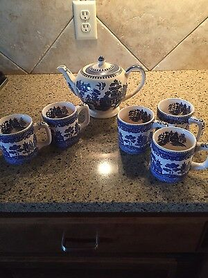 Antique Blue Willow teapot and 5 mugs