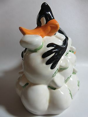 """Daffy Duck Holding On To His Money Coin Bank """"Warner Brothers 1995"""""""