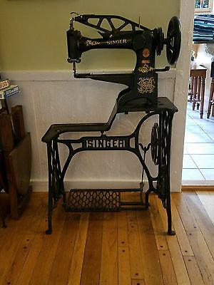 Singer 29-4 sewing machine w base, manual, leather belt, accessories etc