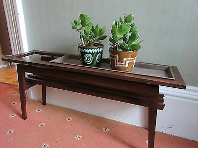 Pair of mid-century teak indoor planters with additional plastic trough tray