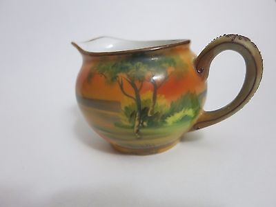 Antique Nippon small Creamer Moriage handle with orange tinted water scene