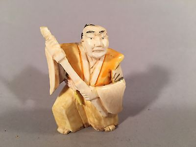Antique Japanese Netsuke Man Holding a Sword