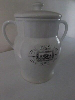 White ceramic cookie jar with lid.  11 in. x 10 in.