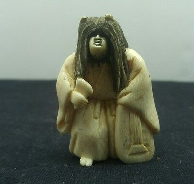 Hand carved and signed japanese netsuke monk with rotating face