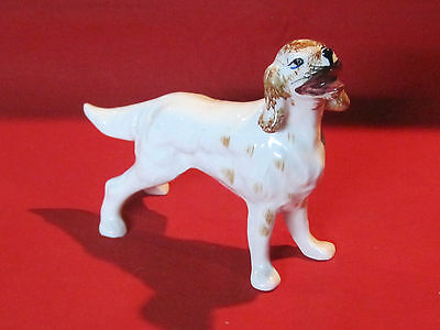 Vintage porcelain Brittany or Springer Spaniel hunting dog figurine