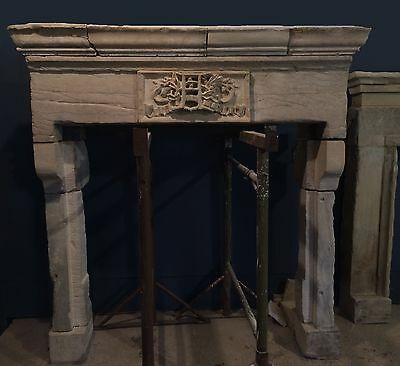fire surround with monogram & oak leaf /antique stone  fireplace