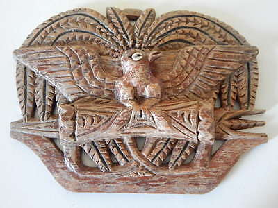 Curious old wooden carving of armorial type (eagle and quiver)