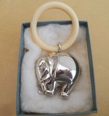 silver plated babies rattle with teething ring in the shape of an elephant