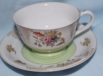 teacup and saucer occupied Japan Merit light green center flowers and gold