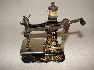 Antique Miniature Toy Sewing Machine - Hand cranked painted numbered with clamp