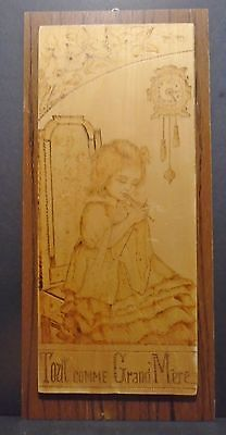 """Quebec Folk Pyrography Art Of a Young Girl Knitting Titled """"Tout Comme Grand Mer"""