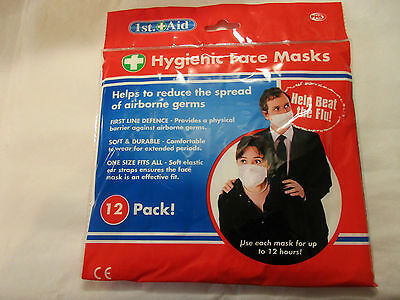 12 pack hygienic face masks (helps to reduce the spread of airborne germs / flu)